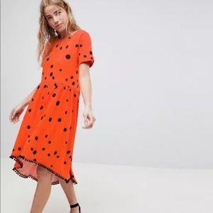 ASOS Design Orange Polka Dot Hi Low Pom Hem Dress